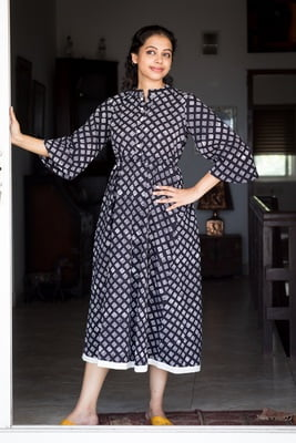 Sadhuram - Black and white fit and flair dress with bell sleeve and drawstrings